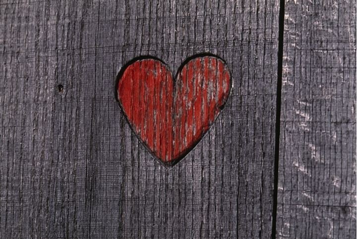 Close-up of heart shape painted on a wooden plank