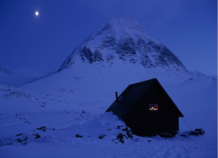 Shed in front of a snow covered mountain, Mt Kebnekaise, Lapland, Sweden