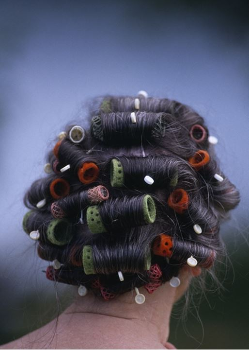 A woman with curlers in her hair