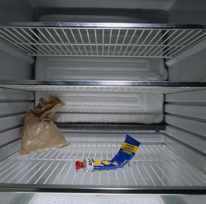 An almost empty refrigerator
