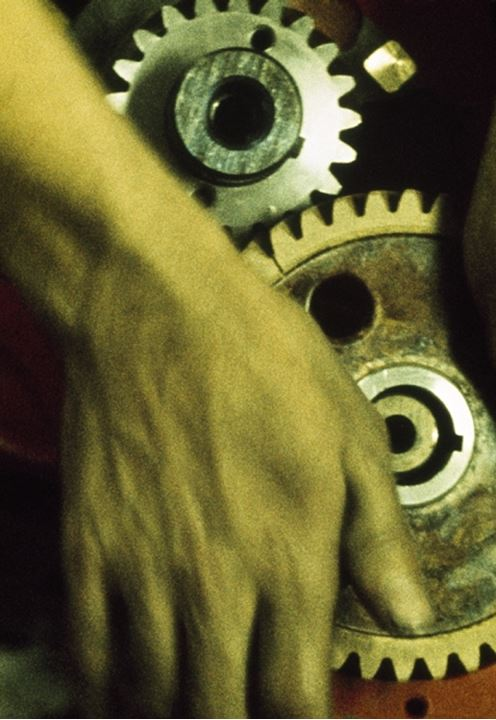 Close-up of a person's hand holding gears