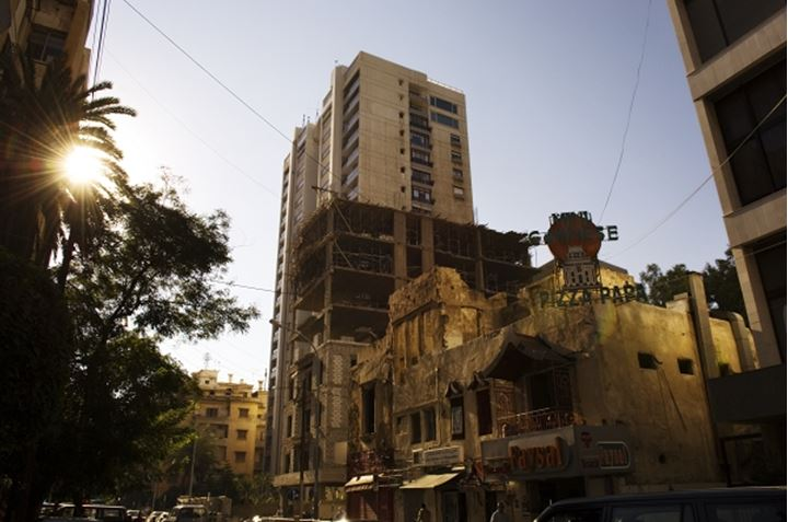 Low angle view of the architectural building by an old building and a building under construction