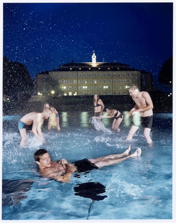 Young people in an outdoor pool