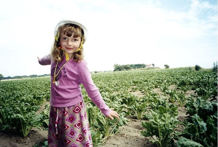 A girl in a ploughed field