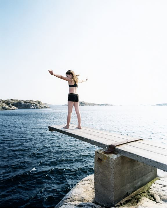 A girl standing on a jumping-off place