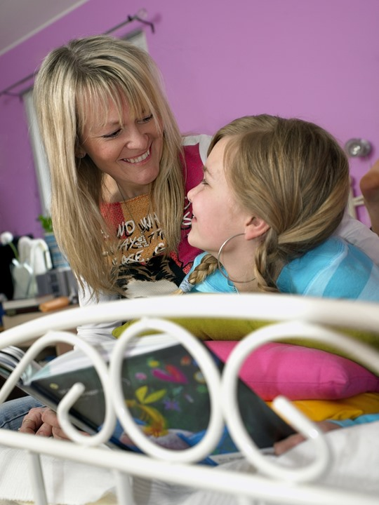Daughter and mother in the nursery