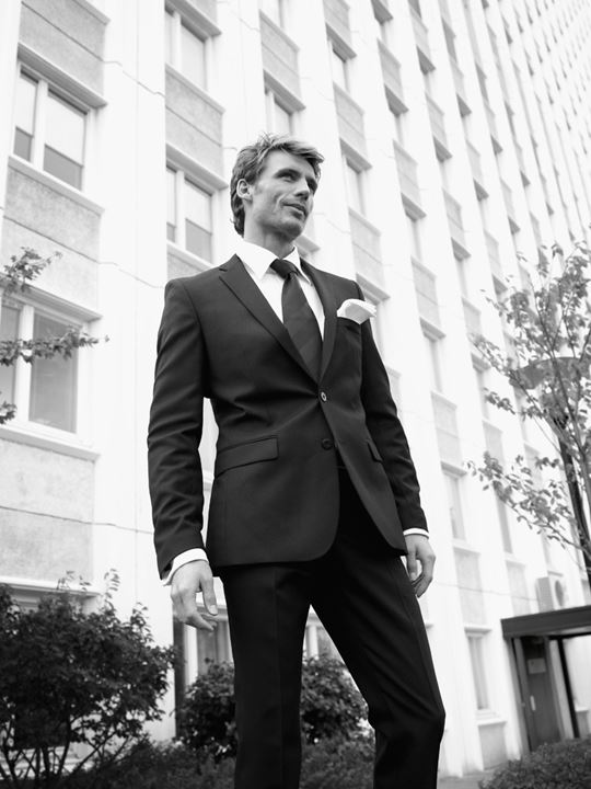 Elegant man standing by an office building