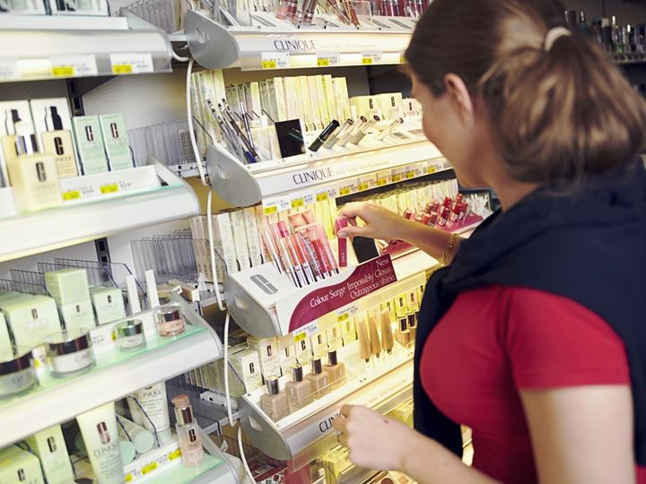 Lady purchasing cosmetics