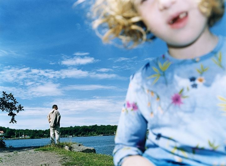 Father and daughter on a lakeside