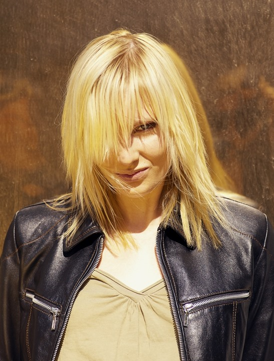 A blonde wearing leather jacket