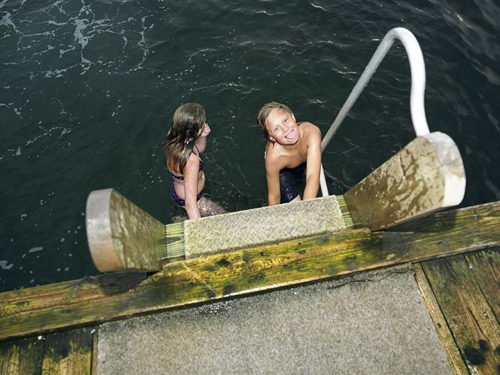 Children on a ladder in the water