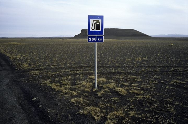 "Road sign ""Filling station is 268 km away"" in the beginning of F88 track, on road number 1 in Myvatn area, Iceland"