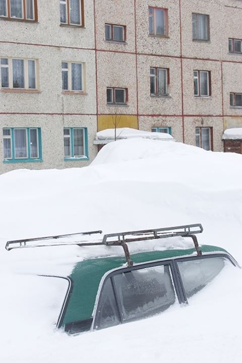 Car covered in snow, Russia