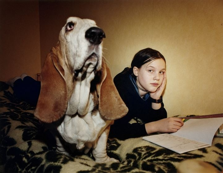 A sad girl and her Basset