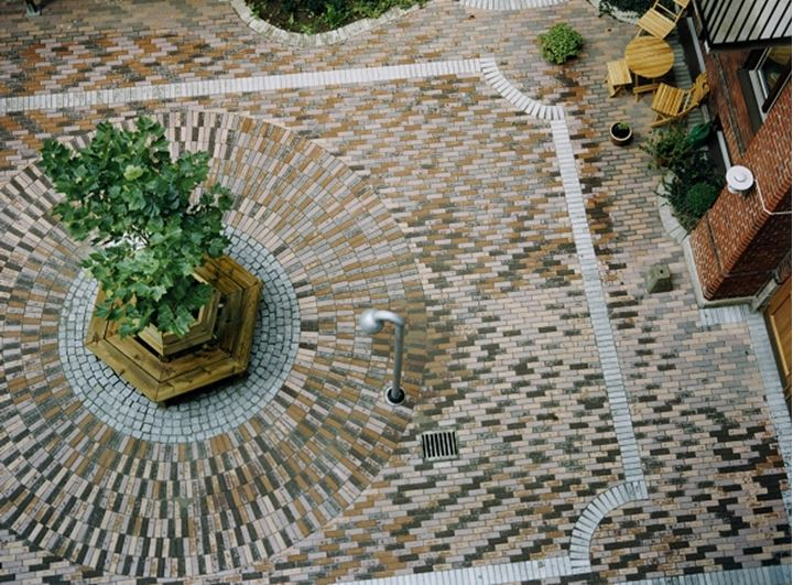 View of a yard paved with bricks