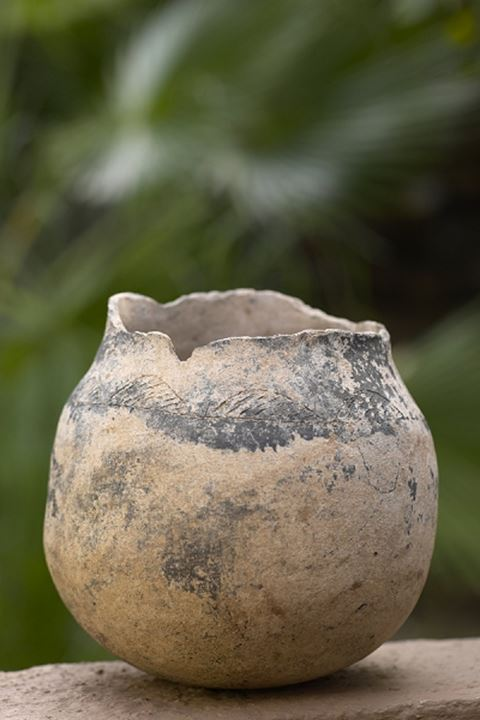 Clay Burial Pot from the Leopard Kopje period (circa AD 1000). Decorations are typical of the Leopard Kopje people and identifies it. Found at Mmamagwa Iron Age site. Nothern Tuli Game Reserve. Botswa