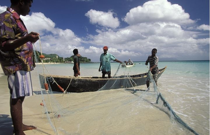 Creole Fishermen working with their nets. Beau Vallon Bay. Mahe'. Seychelles