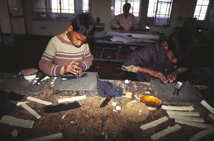 Young boys working in a shoe factory (child labour), India
