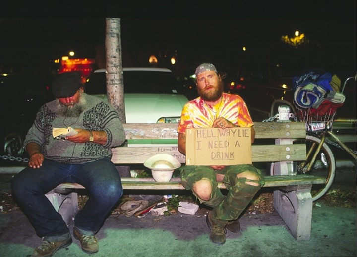 People sitting on the bench at night