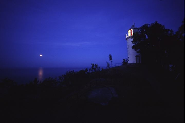 Moon and lighthouse, Sweden