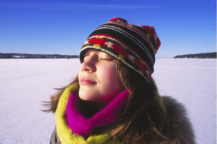 Teenage girl enjoying winter sunshine, Dalarna, Sweden