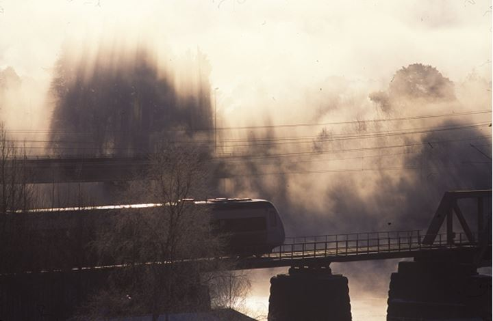 Local train passing over bridge, winter's morning, Dalarna, Sweden
