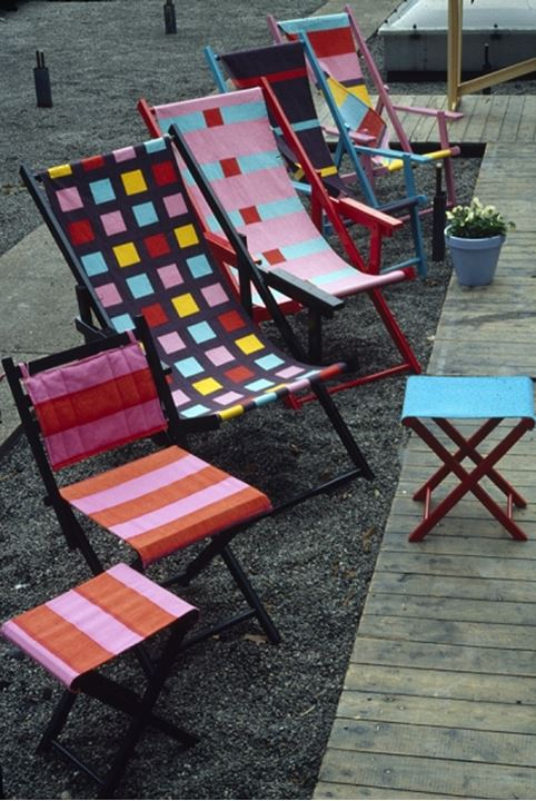 A row of colorful fold chairs
