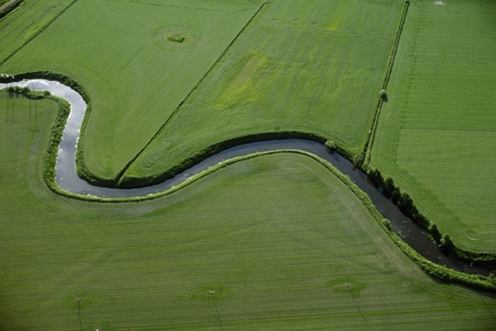 Aerial view of a creek flowing through a landscape