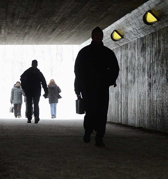 People walking through an underpass