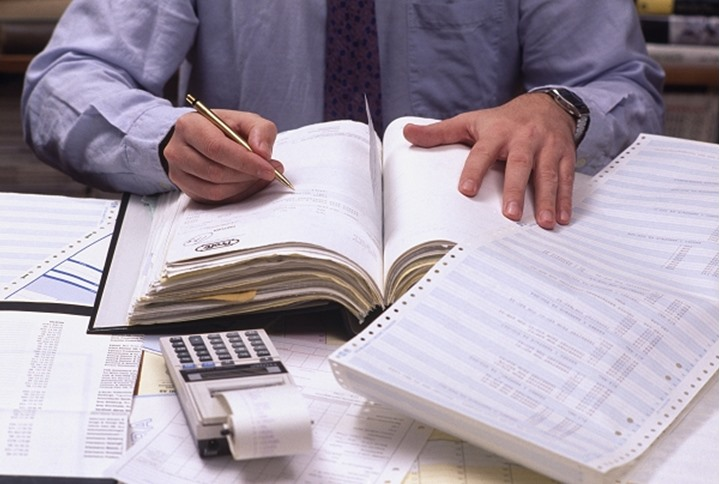 Mid section view of an office worker doing paper work