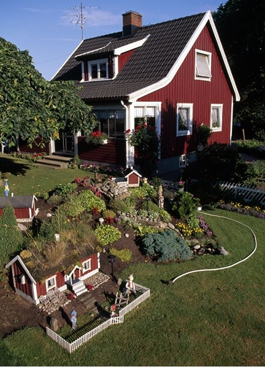 House in Sweden with minature house in garden