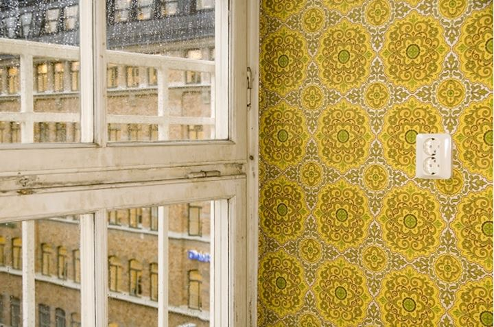 A window and a yellow wallpaper