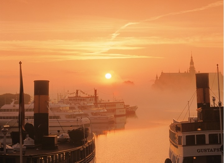 Misty sunrise over Nordiska Museum and Nrybroviken waters in Stockholm