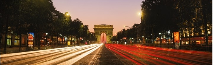 Champs Elysees traffic with Arc De Triomphe at dusk