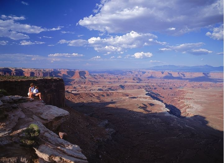 Tourists above Buck Canyon in Canyonlands National Park Utah