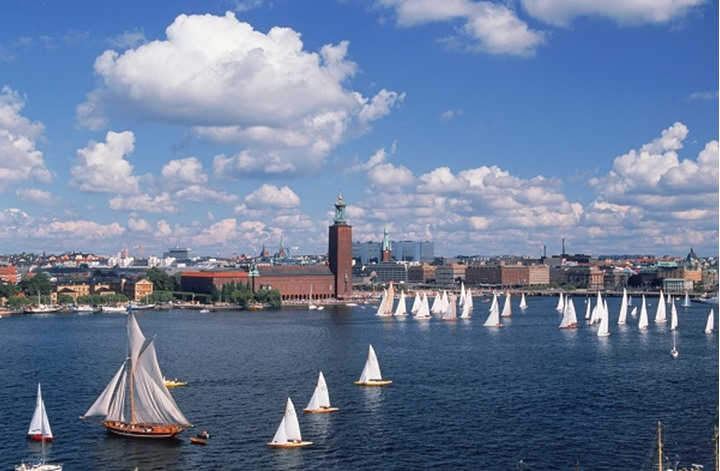 Sailing regatta on Riddarfjarden in Stockholm with City Hall beyond