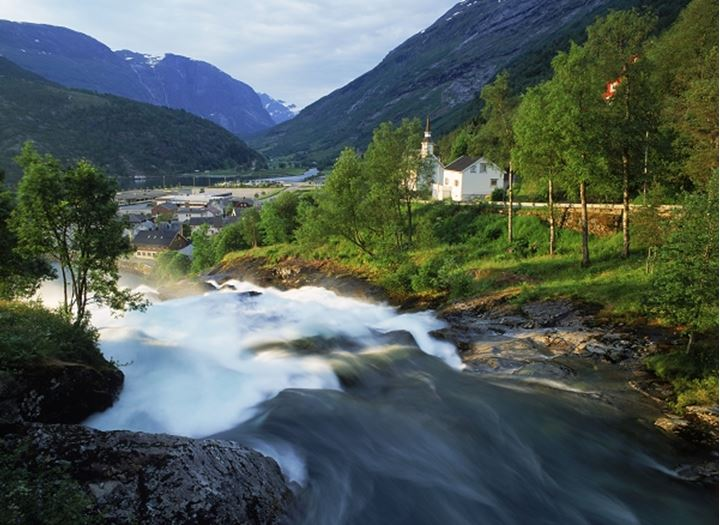 Hellesylt Church and falls at sunrise in More Romsdal area of Norway