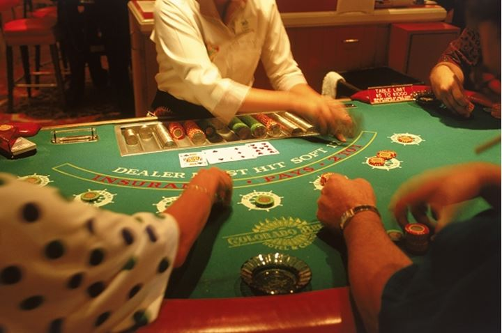 Dealer and players at black jack table in Nevada casino