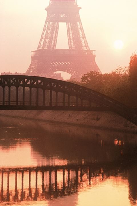 Eiffel Tower and bridge over River Seine in soft sunrise light