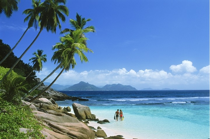 Couple on Anse Severe on La Digue Island in Seychelles