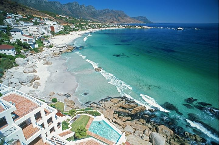 Woman in swimming pool on Indian Ocean near Camps Bay in Cape Town South Africa