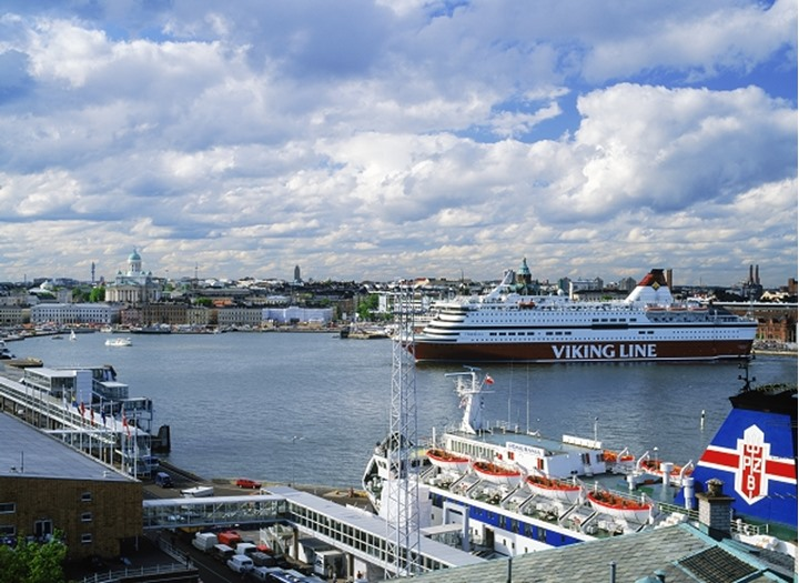 Viking Line passenger ship departing South Harbor of Helsinki with docks and Cathedral