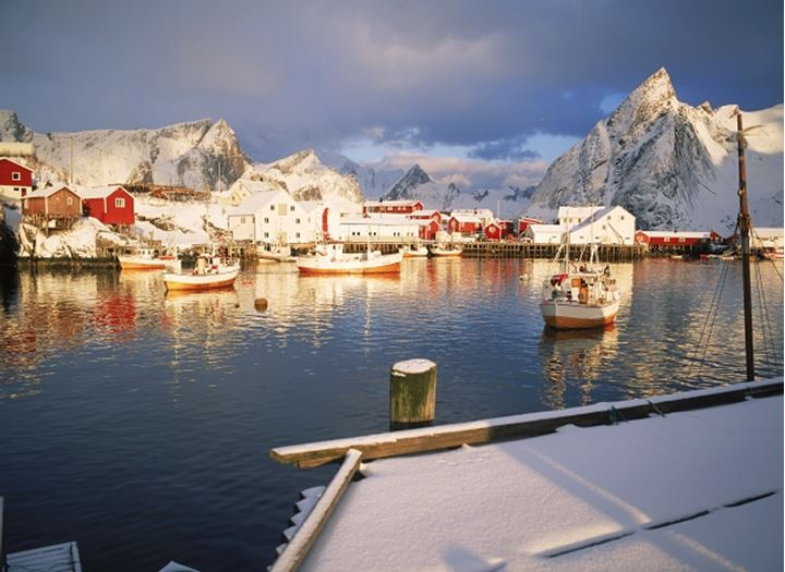 Sunrise and fresh snow in village of Hamnoy on Moskenes Island in Lofotens off Northern Norway