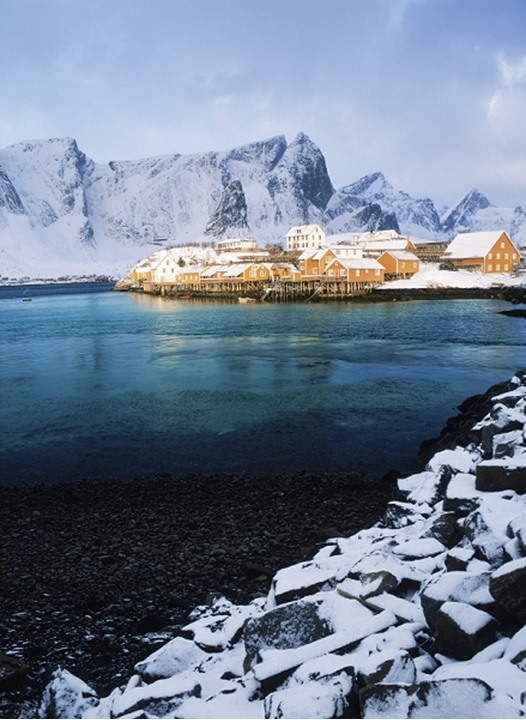 Sunrise light on fishing village of Reine in winter on Moskenes Island in Lofotens in North Sea