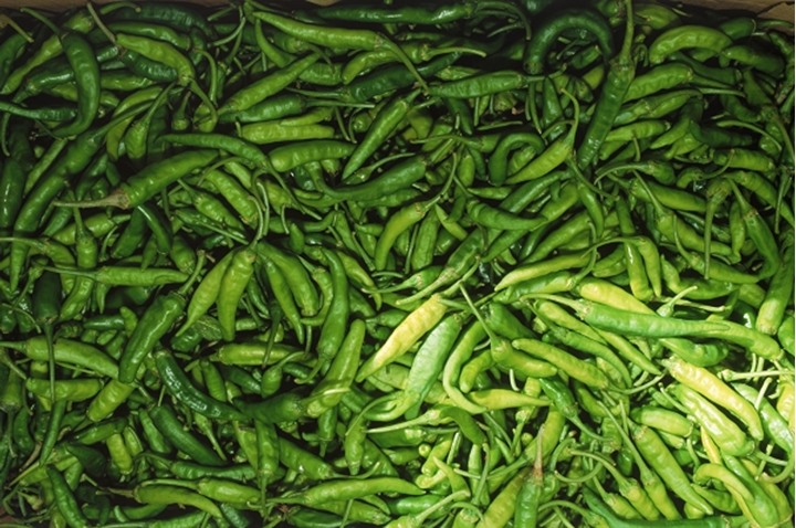 Fresh green chilli peppers in outdoor market in Seychelles