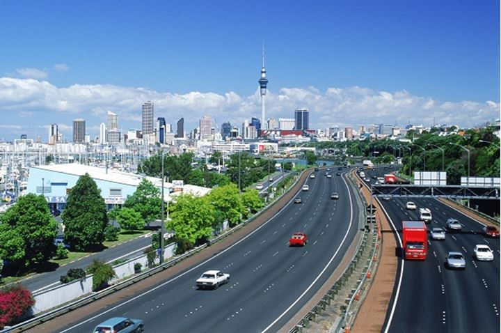 Waitemata Harbour (Westhaven Harbour) on left side of highway into downtown Auckland with Skytower above city