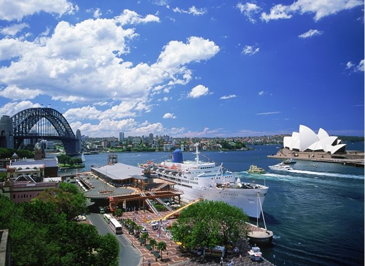 Boat traffic and cruise ship in Sydney Harbour with Opera House and Harbour Bridge