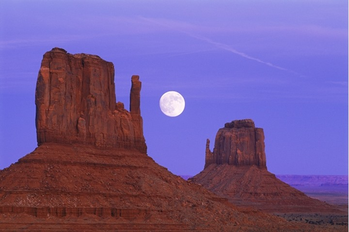 Moonset between the Mittens in Monument Valley  Arizona