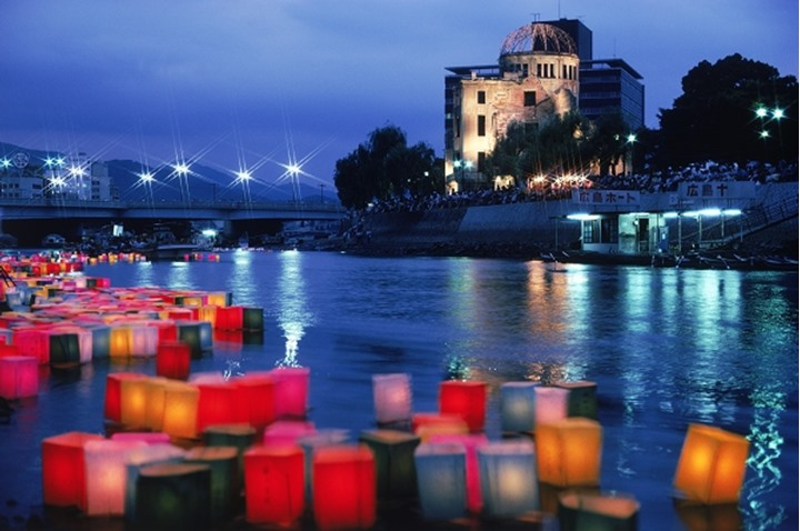 Atomic Bomb Dome with floating lamps on Motoyasu-gawa River during Peace Memorial Ceremony every August 6 in Hiroshima, Japan