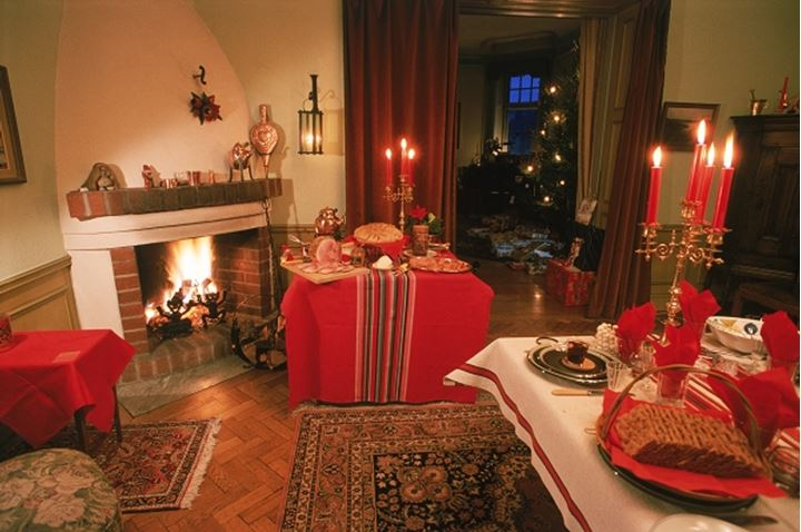 Traditional food, colors and home decorations for family Christmas dinner in Sweden